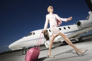 Businesswoman Alighting From Private Jet